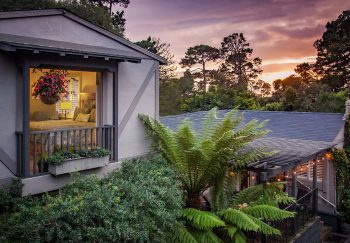 Exterior view of Carmel Country Inn at sunset
