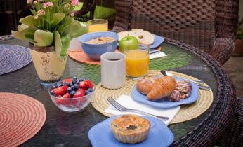Breakfast food on an outdoor patio table