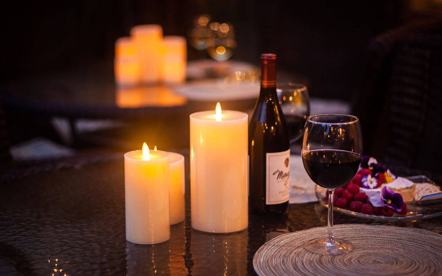 Candles and red wine outdoors