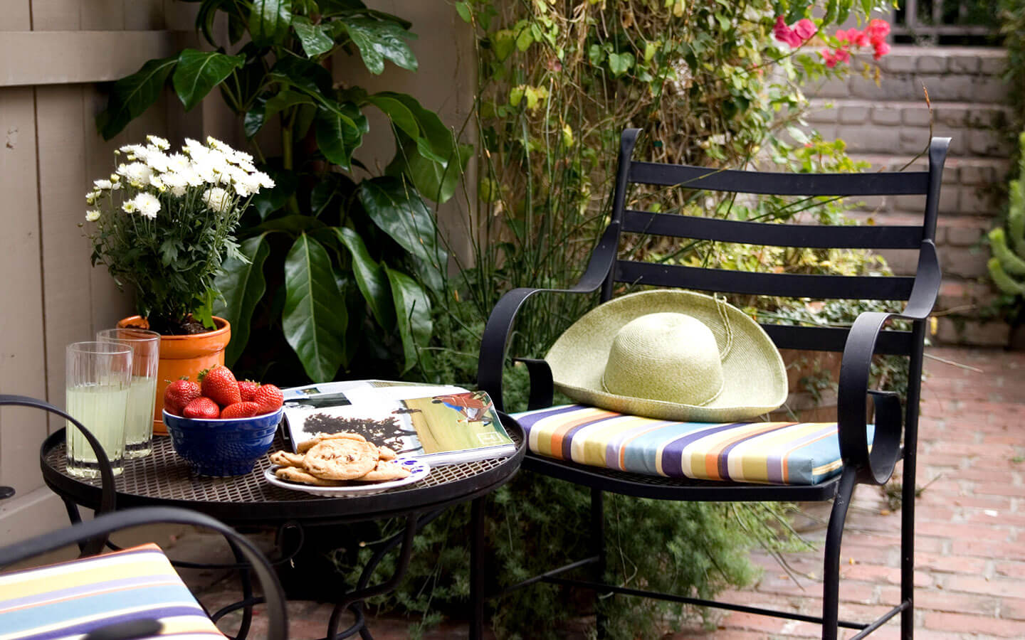 Cookies, fruit, and drinks on a patio table