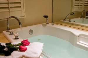 Spa tub with roses on a towel