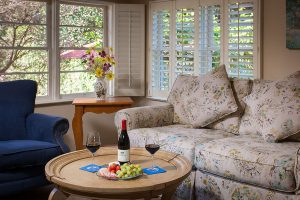 Couch and table with wine and fruit
