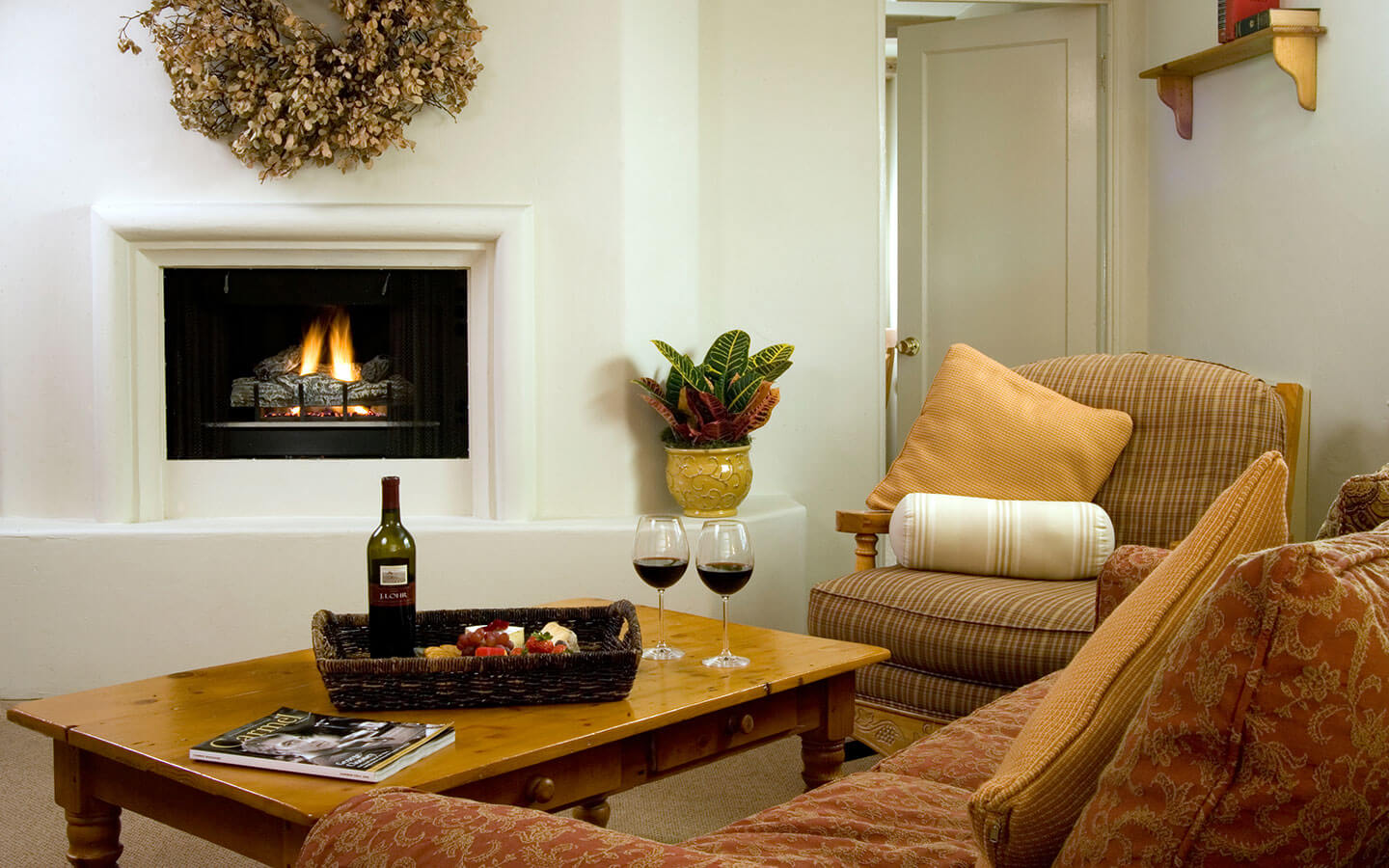 unwind by the fire at our cozy Carmel bed and breakfast