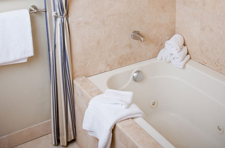 enjoy a bubble bath in the whirlpool tub after a day of exploring