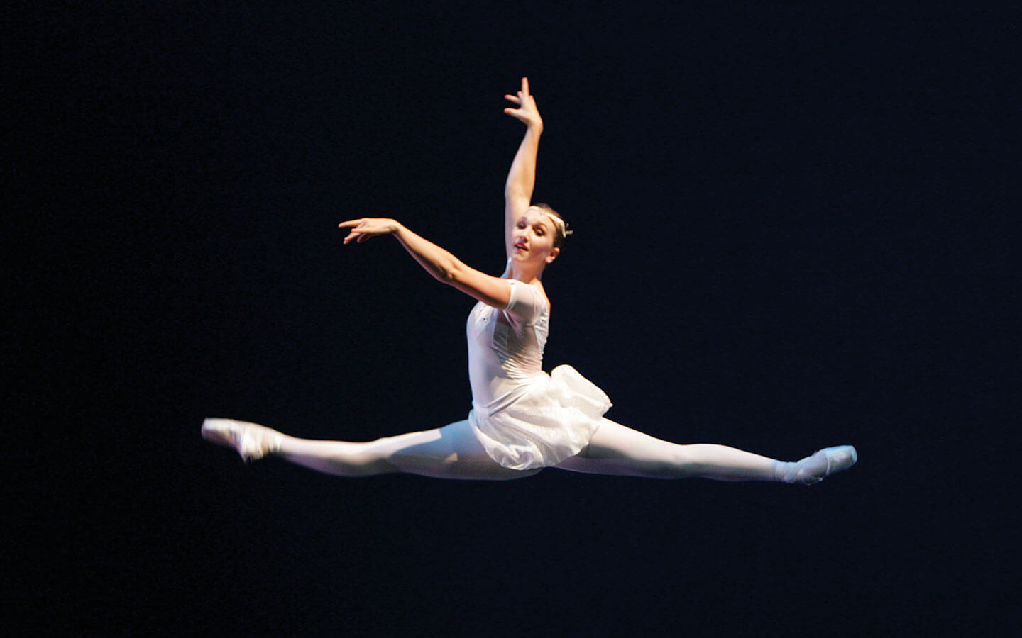Ballerina jumping during a performance