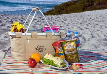 Picnic on the beach with a Carmel Country Inn basket
