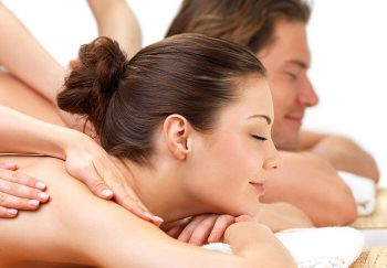 Couple enjoying getting a massage together