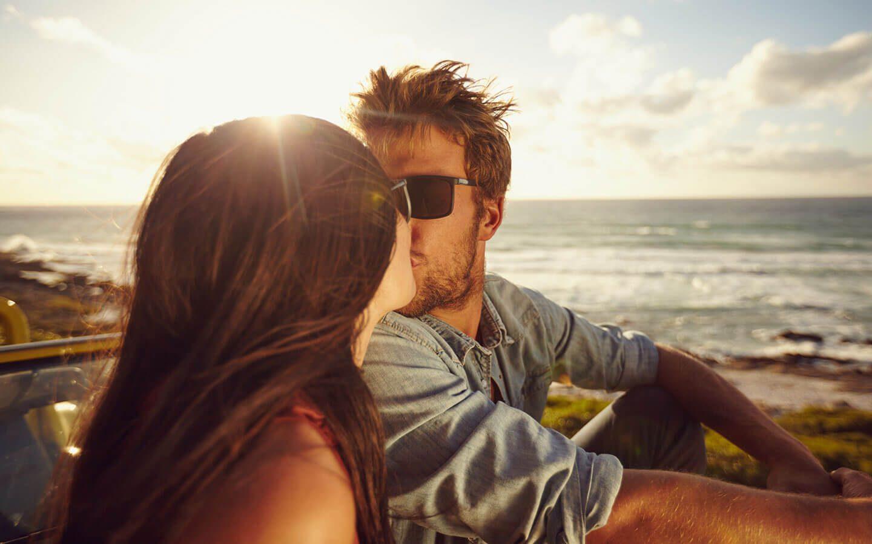 Couple on the beach in Carmel, CA