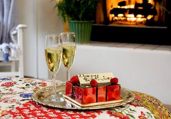 Sweet Bubbly Package with cake and champagne by the fire