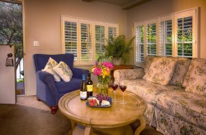 Living room with couch, chair, and table with wine and cheese plate
