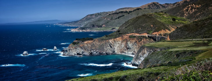 A sunny day view of the ocean and cliffs in Big Sur