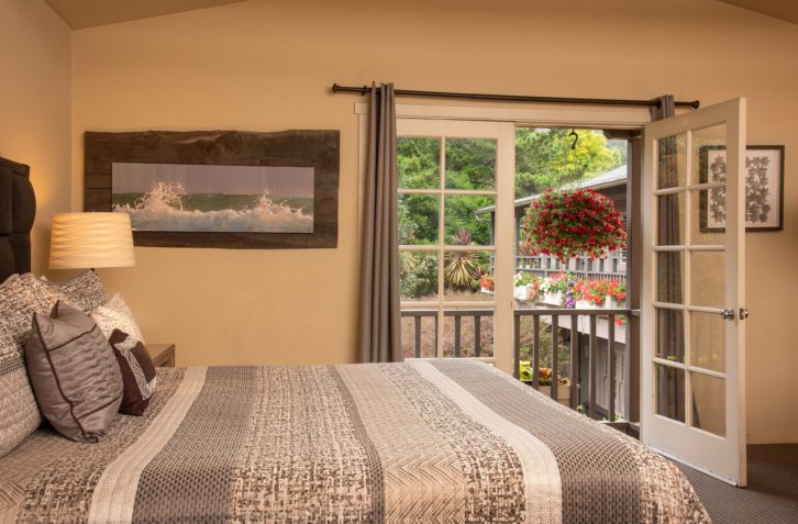 Stunning views from a spacious studio out french doors at our Carmel inn