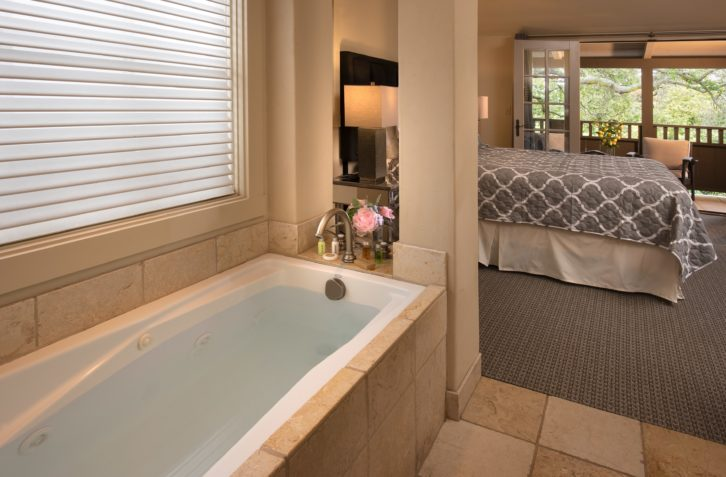 whirlpool tub open to the room