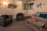 sitting room in two bedroom two bath suite with gray decor dutch door