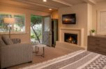 A flat screen TV, gas fireplace and elegant finishings