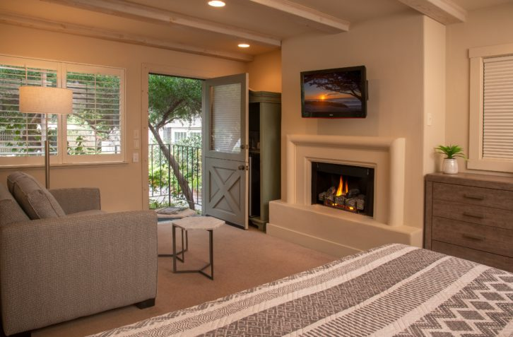 Fireplace room with private balcony at Carmel B&B