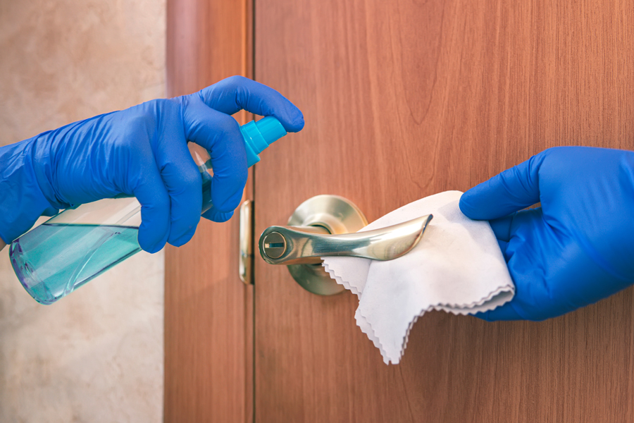 blue gloves with cleaning wipe