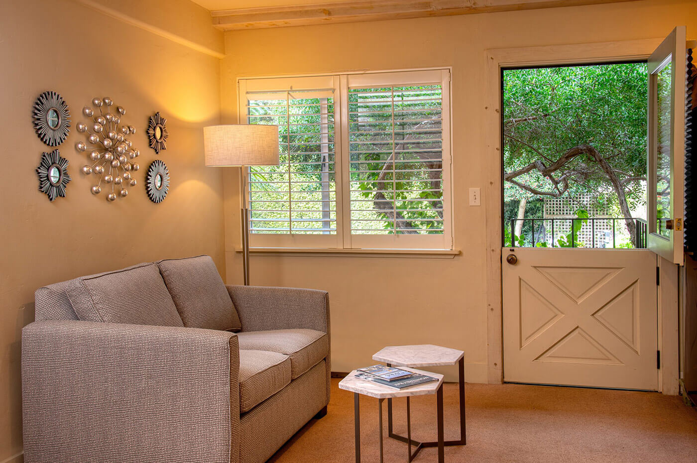 guest room seating area at our Carmel-by-the-Sea boutique hotel