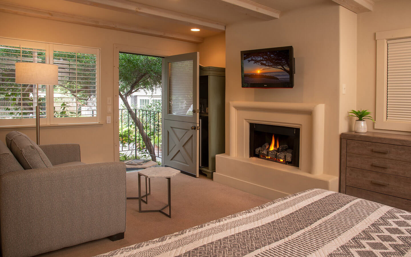 guest room with fireplace at our boutique hotel in Carmel-by-the-Sea