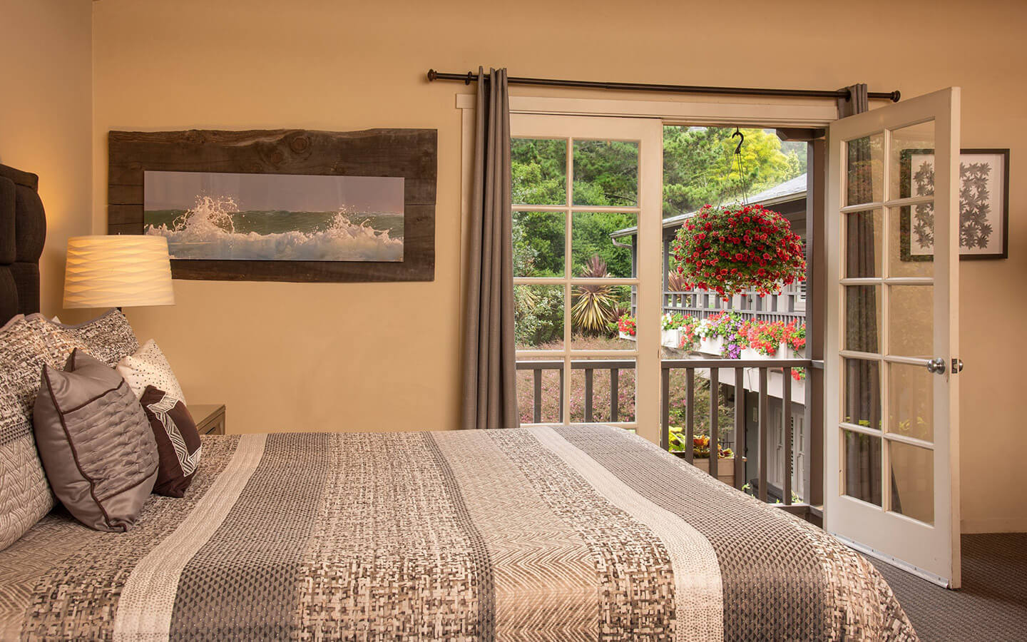 bed in a guest room at our Carmel boutique hotel